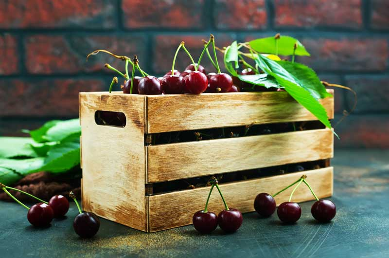 wood crate with cherries