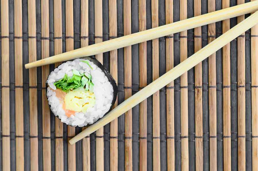 wooden chopsticks with sushi